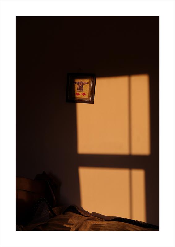 Jiayi Lyu - Light cast on a wall through a window