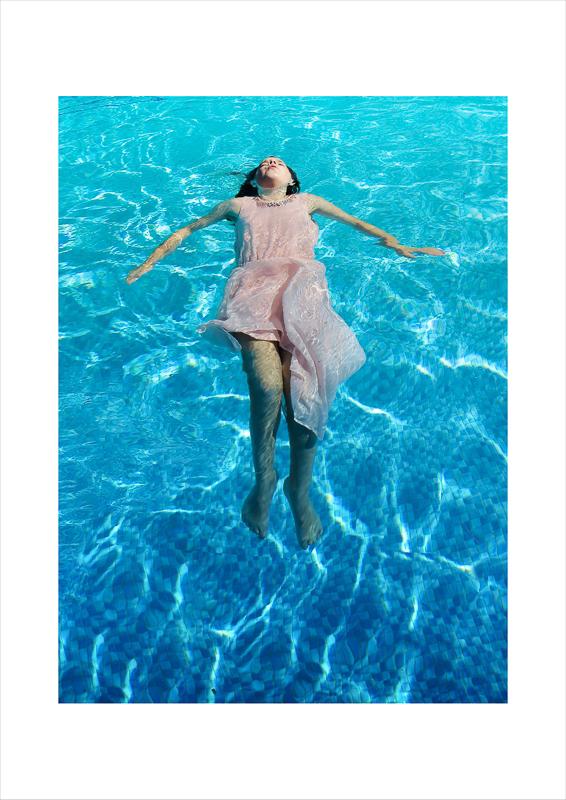 Tabitha Udy - Girl lying in pool