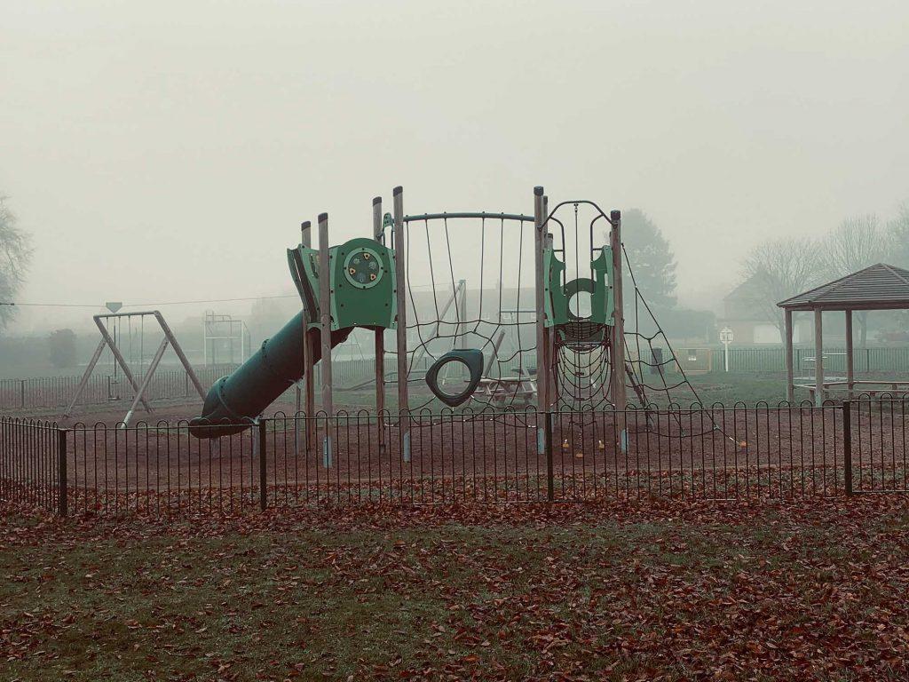 Cameron Wolstencroft - Children's metal play area in the mist